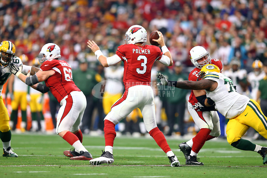 Dec 27, 2015; Glendale, AZ, USA; Arizona Cardinals quarterback Carson Palmer (3) against the Green Bay Packers at University of Phoenix Stadium. Mandatory Credit: Mark J. Rebilas-USA TODAY Sports
