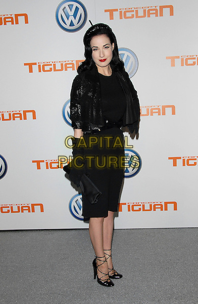 DITA VON TEESE.Attends Volkswagen US Premiere of Concept Tiguan held at Raleigh Studios in Los Angeles, California, USA,.November 28, 2006..full length black strappy shoes long gloves cropped jacket pencil skirt hairband hairband clutch bag.CAP/DVS.©Debbie VanStory/Capital Pictures