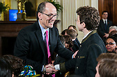 United States Secretary of Labor Thomas Perez, left, greets attendees at an event in the East Room of the White House in Washington, D.C. on March 13, 2014. Before signing a memorandum, the president explained that overtime rules have eroded for salaried workers, who may put in more than a 40-hour workweek without earning overtime and in some cases may make less than minimum wage. <br /> Credit: T.J. Kirkpatrick / Pool via CNP