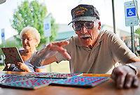 Jim Reid watches his six Bingo cards like a hawk while Inez Digiuseppe has fun playing a single card Friday night at the Bingo game at the Fauquier County Fair in Warrenton, VA.