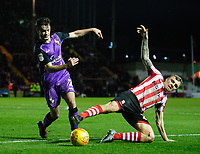 Lincoln City's Harry Anderson vies for possession with Port Vale's James Gibbons<br /> <br /> Photographer Chris Vaughan/CameraSport<br /> <br /> The EFL Sky Bet League Two - Lincoln City v Port Vale - Tuesday 1st January 2019 - Sincil Bank - Lincoln<br /> <br /> World Copyright &copy; 2019 CameraSport. All rights reserved. 43 Linden Ave. Countesthorpe. Leicester. England. LE8 5PG - Tel: +44 (0) 116 277 4147 - admin@camerasport.com - www.camerasport.com