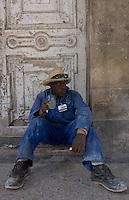 worker taking a break, street scene in Havana, Cuba