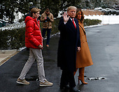 United States President Donald J. Trump, first lady Melania Trump, and their son, Barron, depart the South Lawn of the White House in Washington, D.C. for a weekend in Florida, February 1, 2019.<br /> Credit: Martin H. Simon / CNP