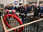 Marine PFC Elgin Scherff of Waterloo salutes after placing a wreath during the ceremony. The city of Belleville held their 21st annual Veterans Day ceremony inside Belleville City Hall on Thursday November 11, 2019. It was moved inside due to the winter weather.<br />