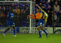 Lyle Taylor of AFC Wimbledon picks up Luke O'Nien of Wycombe Wanderers and throws him to the ground during the Sky Bet League 2 match between AFC Wimbledon and Wycombe Wanderers at the Cherry Red Records Stadium, Kingston, England on 21 November 2015. Photo by Alan  Stanford/PRiME.