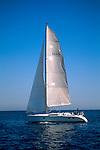 Blue sky, calm water, and sailboat in the Santa Barbara Channel, near Anacapa Island, California Coast