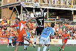 02 June 2012: Puerto Rico's Richard Martin (ENG) (1) catches the ball under pressure from Carolina's Nick Zimmerman (23) as Puerto Rico's Tyler Wilson (PUR) (17) watches. The Carolina RailHawks defeated the Puerto Rico Islanders 2-1 at WakeMed Soccer Stadium in Cary, NC in a 2012 North American Soccer League (NASL) regular season game.