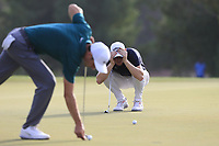 Ross Fisher (ENG) and Thomas Pieters (BEL)on the 15th green during the 2nd round of the DP World Tour Championship, Jumeirah Golf Estates, Dubai, United Arab Emirates. 16/11/2018<br /> Picture: Golffile | Fran Caffrey<br /> <br /> <br /> All photo usage must carry mandatory copyright credit (© Golffile | Fran Caffrey)