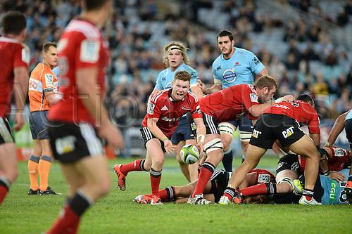23.05.2015.  Sydney, Australia. Super Rugby. NSW Waratahs versus the Crusaders. Crusaders scrum half Mitchell Drummond plays the ball along his line. The Waratahs won 32-22.