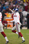 New York Giants kicker Lawrence Tynes (9) celebrates the winning field goal in overtime during an NFC Championship NFL football game against the San Francisco 49ers on January 22, 2012 in San Francisco, California. The Giants won 20-17 in overtime. (AP Photo/David Stluka)