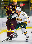 24 November 2012: University of Vermont Catamount forward H.T. Lenz, a Junior from Vienna, VA, checks defenseman Seth Helgeson, a Senior from Faribault, MN, during first period action against the University of Minnesota Golden Gophers at Gutterson Fieldhouse in Burlington, Vermont. The Catamounts fell to the Gophers 3-1 in the second game of their 2-game non-divisional weekend series. Mandatory Credit: Ed Wolfstein Photo