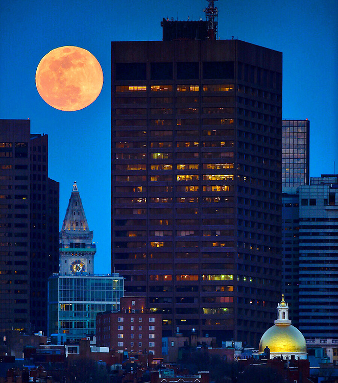 BOSTON, MA - MARCH 20: The Super Worm Moon rises in conjunction with the Spring Equinox over downtown Boston, Massachusetts on March 20, 2019. Photo by Christopher Evans