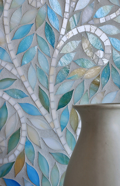 Climbing Vine, a jewel glass waterjet mosaic, is shown in Quartz and Aquamarine and is part of the Silk Road collection by New Ravenna.