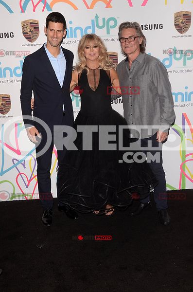 BEVERLY HILLS, CA - NOVEMBER 03: Novak Djokovic, Goldie Hawn, Kurt Russell at Goldie's Love In For Kids at Ron Burkle's Green Acres Estate on November 3, 2017 in Beverly Hills, California. Credit: David Edwards/MediaPunch