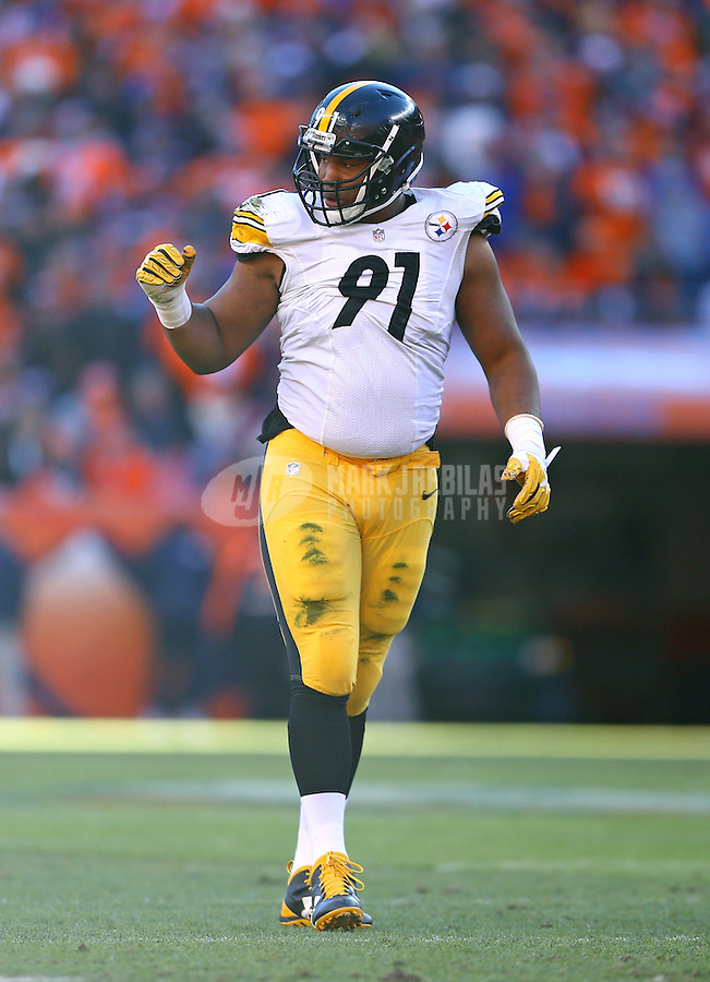 Jan 17, 2016; Denver, CO, USA; Pittsburgh Steelers defensive end Stephon Tuitt (91) reacts against the Denver Broncos during the AFC Divisional round playoff game at Sports Authority Field at Mile High. Mandatory Credit: Mark J. Rebilas-USA TODAY Sports