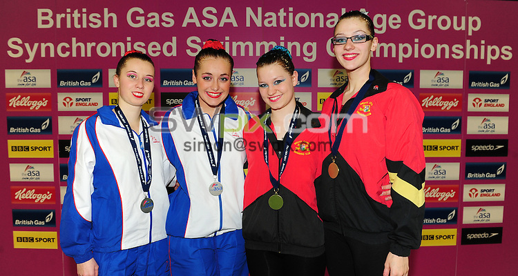 PICTURE BY ALEX BROADWAY/SWPIX.COM - Synchronised Swimming - British Gas ASA National Age Group Synchronised Swimming Championships 2011 - GL1 Leisure Centre, Gloucester, England - 03/12/11 - Eliza Rice & Eniko Toth of Trafford SSC and Isabelle Collings & Charlotte Frost of Bristol Central SC pose with their medals from the 18-19yrs Free Routine Duet.