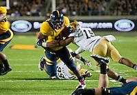 October 6th, 2012: California's C.J. Anderson rushing through against UCLA defender during a game at Memorial Stadium, Berkeley, Ca    California defeated UCLA 43 - 17