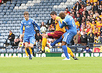 John Sutton controlling the ball under pressure from Michael Duberry