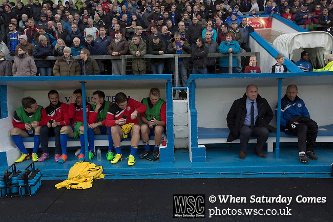 Carlisle United 1 Accrington Stanley 0, 15/11/2014. Brunton Park, League Two. Visiting manager John Coleman (second from right) sitting in the away dugout prior to kick-off at the English League Two match between Carlisle United and visitors Accrington Stanley at Brunton Park. The match was won by the home team by one goal to nil, the winner scored by Derek Asamoah in the 21st minute. The match was watched by 4,069 spectators. Photo by Colin McPherson.