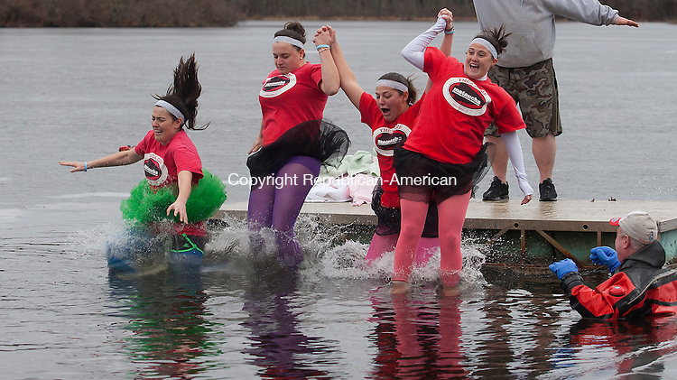WATERTOWN, CT - 16 JANUARY 2016 - 011616JW01.jpg --The team of Tina MacSweeney, Molly Simms, Heather Stasaitis, and Carolyn Hubeny take a leap into the icy water  during the 3rd Annual Polar PLunge at YMCA Camp Mataucha Saturday afternoon. The event raised approximately $6,000, the proceeds going towards the Meghan Beebe Camp Scholarship.   Jonathan Wilcox Republican-American