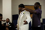Aaron Ross, New York Giants cornerback, gets dressed before his wedding to Sanya Richards, Olympic gold medalist, at the Hyde Park Baptist Church in Austin, Texas on Friday, February 26, 2010. The couple met while participating in the athletics programs at the University of Texas...