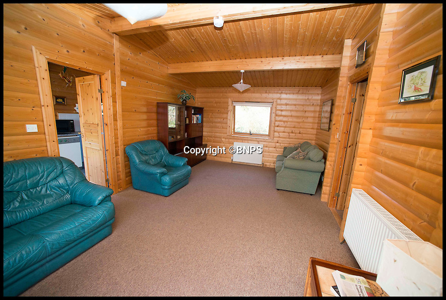 BNPS.co.uk (01202 558833)<br /> Pic: LauraDale/BNPS<br /> <br /> The living room.<br /> <br /> A dream home...at a price - chance to buy your very own log cabin in a wood.<br /> <br /> A rare opportunity has arisen to own this idyllic log cabin nestled in the heart of ancient forest - but prospective buyers will have to dig deep because it comes with a whopping £350,000 price tag.<br /> <br /> The quaint wooden retreat is down a private track in the the New Forest, the medieval hunting grounds of William the Conqueror, offering peace and quiet for those looking to escape the stresses of modern life.<br /> <br /> The woodland bolthole might look like a holiday home but unlike its counterparts it comes with permission to live in it all year round.<br /> <br /> But its ideal location on the edge of a tiny hamlet in the west of New Forest National Park means it is worth more than twice what a similar holiday cabin at a home park would be worth.