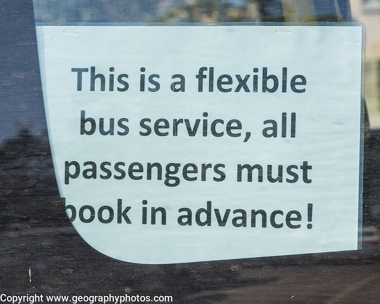 Sign for flexible bus service requiring advanced booking, Woodbridge, Suffolk, England, UK