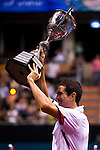 BANGKOK, THAILAND - OCTOBER 03:  Guillermo Garcia-Lopez of Spain celebrates with the trophy after winning the singles final match against Jarkko Nieminen of Finland during the Day 9 of the PTT Thailand Open at Impact Arena on October 3, 2010 in Bangkok, Thailand. Photo by Victor Fraile / The Power of Sport Images