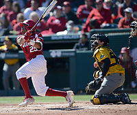 NWA Democrat-Gazette/ANDY SHUPE<br /> Arkansas left fielder Christian Franklin connects for a sacrifice fly Saturday, March 16, 2019, to score Casey Opitz during the second inning against Missouri at Baum-Walker Stadium in Fayetteville. Visit nwadg.com/photos to see more photographs from the game.