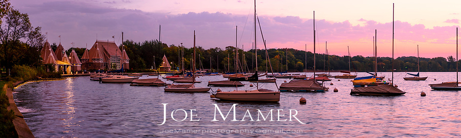 Sailboats moored on Lake Harriet at dawn.