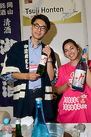 Tsuji Soichiro (left), owner of Tsuji Honten sake brewery, Hyper Japan 2014, Earls Court, London, UK, July 25, 2014. Hyper Japan is the UK's largest Japanese culture event. It took place at the Earls Court exhibition space from 25 to 27 July 2014.