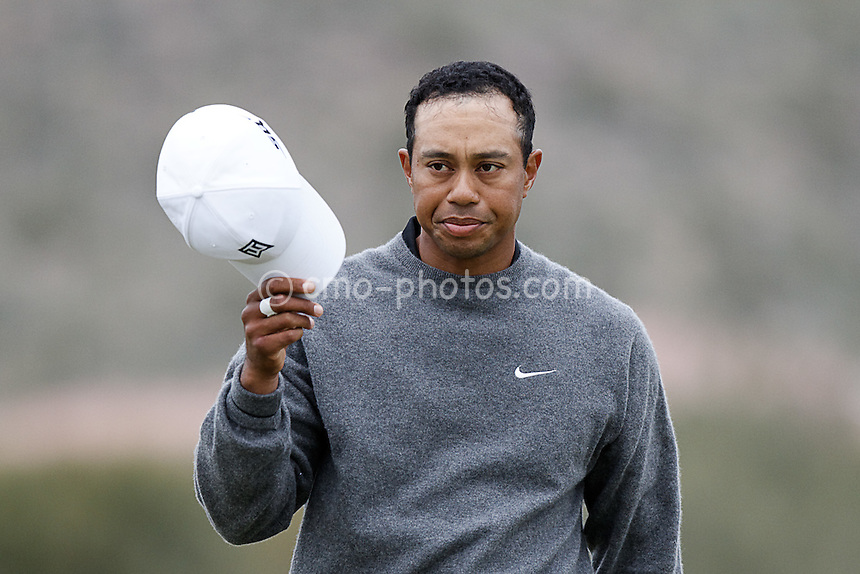 Feb 22, 2008; Marana, AZ, USA; Tiger Woods removes his cap after winning his third round match in 20 holes against Aaron Baddeley (not pictured) at the Accenture Match Play Championship at the Gallery Golf Club.