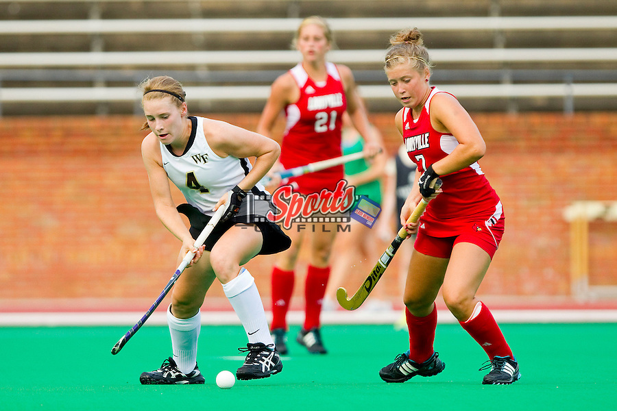 Christine Conroe #4 of the Wake Forest Demon Deacons tries to control the ball as Mallory Mason #7 of the Louisville Cardinals defends at Kentner Stadium on September 4, 2011 in Winston-Salem, North Carolina.  The Demon Deacons defeated the Cardinals 3-2 in overtime.  (Brian Westerholt / Sports On Film)