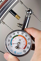 TIRE PRESSURE GAUGE<br /> Close up of bicycle tire<br /> The compression of the spring is proportional to the force on it, which is in turn proportional to the air pressure in the tire.