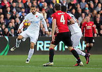 Fernando Llorente of Swansea City (L) crosses the ball into the Manchester United box during the Premier League match between Swansea City and Manchester United at The Liberty Stadium, Swansea, Wales, UK. Sunday 06 November 2016