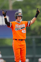 Oklahoma State Cowboys third baseman Craig McConaughy #40 celebrates at second after hitting a double during the NCAA baseball game against the Texas Longhorns on April 26, 2014 at UFCU Disch–Falk Field in Austin, Texas. The Cowboys defeated the Longhorns 2-1. (Andrew Woolley/Four Seam Images)