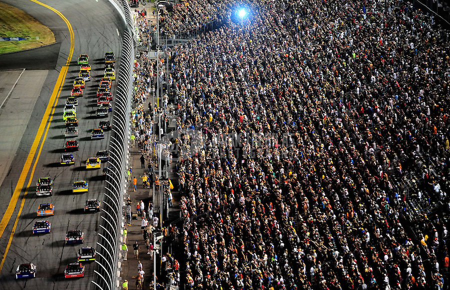 Jul. 3, 2010; Daytona Beach, FL, USA; NASCAR Sprint Cup Series drivers race into turn one on the first lap during the Coke Zero 400 at Daytona International Speedway. Mandatory Credit: Mark J. Rebilas-