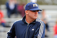 11 February 2012:  FIU Head Coach Jake Schumann watches his players as the University of Louisville Cardinals defeated the FIU Golden Panthers, 4-2, as part of the COMBAT Classic at the FIU Softball Complex in Miami, Florida.
