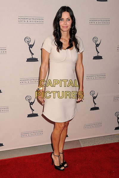 "COURTENEY COX.An Evening With ""Cougar Town"" held at the Academy Of Television Arts & Sciences, North Hollywood, California, USA, 20th April 2011..full length black shoes open toe t-bar sandals cream nude dress .CAP/ADM/BP.©Byron Purvis/AdMedia/Capital Pictures."