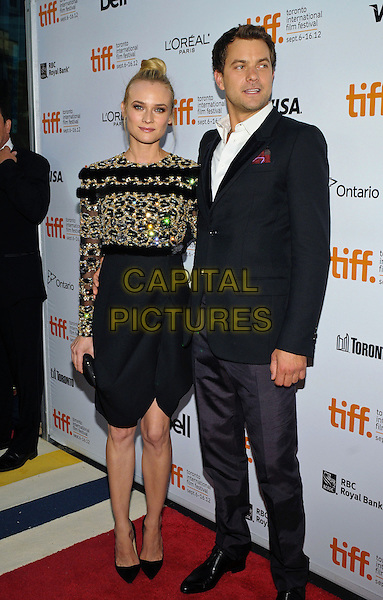 "Diane Kruger & Joshua Jackson.""Inescapable"" Premiere - 2012 Toronto International Film Festival held at Ryerson Theatre, Toronto, Ontario, Canada..September 11th, 2012.TIFF full length black gold embellished jewel encrusted hair up bun skirt wrap white shirt blue suit couple .CAP/ADM/BPC.©Brent Perniac/AdMedia/Capital Pictures."