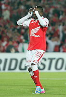BOGOTA - COLOMBIA- 28 -05-2013:  Jefferson Cuero  jugador de  Santa Fe de Colombia   celebra su gol  contra  Garcilaso del Perú  durante   partido en el estadio El Campín de la ciudad de Bogotá, mayo 28  de 2013. partido por la  Copa Bridgestone  Libertadres de America. (Foto: VizzorImage / Felipe Caicedo / Staff).Playe Jefferson Cuero  Santa Fe of Colombia celebrates his goal against Garcilaso  of Peru during game at El Campin in Bogota, May 28, 2013. Bridgestone Cup match Libertadores of America .  (Foto: VizzorImage / Felipe Caicedo / Staff).