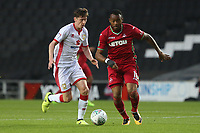 Jordan Ayew of Swansea City is marked by Conor McGrandles of MK Dons during the Carabao Cup Second Round match between MK Dons and Swansea City at StadiumMK, Milton Keynes, England, UK. 22 August 2017