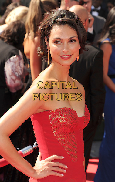 Morena Baccarin.2012 Creative Arts Emmy Awards at Nokia Theatre L.A. Live, Los Angeles, California USA..15 September 2012.emmys  half length red strapless maxi dress hand on hip netting.CAP/ROT/TM.© TM/Roth/Capital Pictures