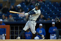 Rafael Ortega (5) of the Gwinnett Braves follows through on his swing against the Durham Bulls at Durham Bulls Athletic Park on April 20, 2019 in Durham, North Carolina. The Bulls defeated the Braves 3-2 in game two of a double-header. (Brian Westerholt/Four Seam Images)