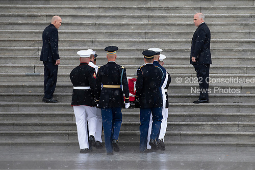 A United States Military Honor Guard carries the casket of former Senator John McCain, Republican of Arizona, up the stairs of the Capitol in Washington, DC on August 31, 2018 in Washington, DC. McCain, a United States Military veteran and longtime Senator, will lay in state inside the Capitol Rotunda for one day prior to being laid to rest on September 1, 2018 at the United States Naval Academy in Annapolis, Maryland. Credit: Alex Edelman / CNP