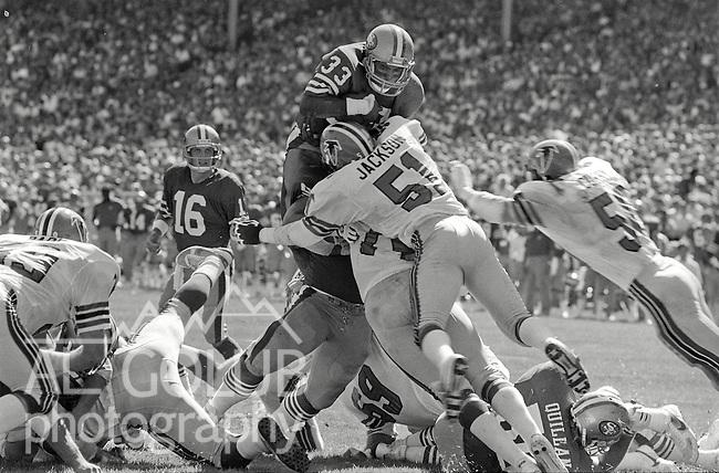 San Francisco 49ers vs. Atlanta Falcons at Candlestick Park Sunday, September 15, 1985..49ers beat the Falcons 35-16.San Francisco 49ers Running Back Roger Craig (33) stopped by Falcon defense. ..