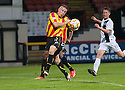 Partick's John Baird scuff the ball when it looked easier to score.