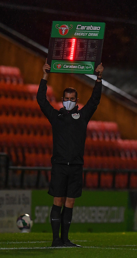 The 4th official signals 1 minute extra on the 'Caraboa' board<br /> <br /> Photographer Dave Howarth/CameraSport<br /> <br /> Carabao Cup Second Round Northern Section - Rochdale v Sheffield Wednesday - Tuesday 15th September 2020 - Spotland Stadium - Rochdale<br />  <br /> World Copyright © 2020 CameraSport. All rights reserved. 43 Linden Ave. Countesthorpe. Leicester. England. LE8 5PG - Tel: +44 (0) 116 277 4147 - admin@camerasport.com - www.camerasport.com