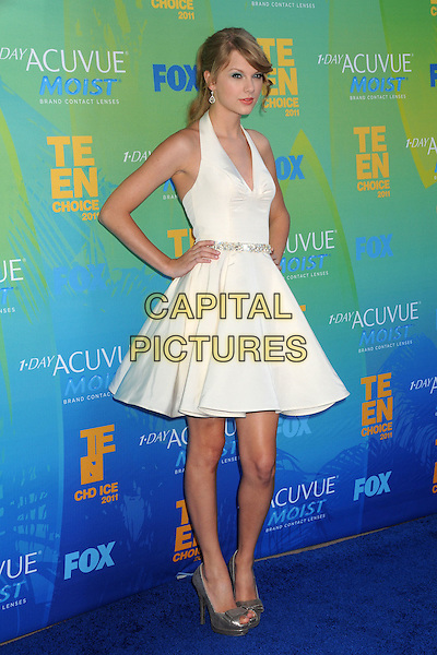 Taylor Swift.2011 Teen Choice Awards - Arrivals held at Gibson Amphitheatre, Universal City, California, USA..August 7th, 2011.full length white halterneck dress hands on hips silver shoes .CAP/ADM/BP .©Byron Purvis/AdMedia/Capital Pictures.