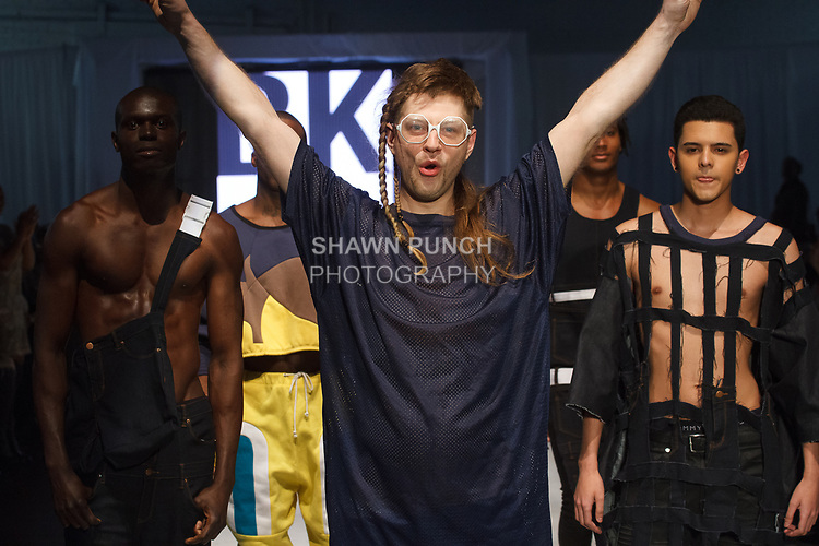 Fashion designer walks runway with models at the his menswear 2017 collection fashion show, at the Brooklyn EXPO Center on April 1, 2017 during Fashion Week Brooklyn Fall Winter 2017.